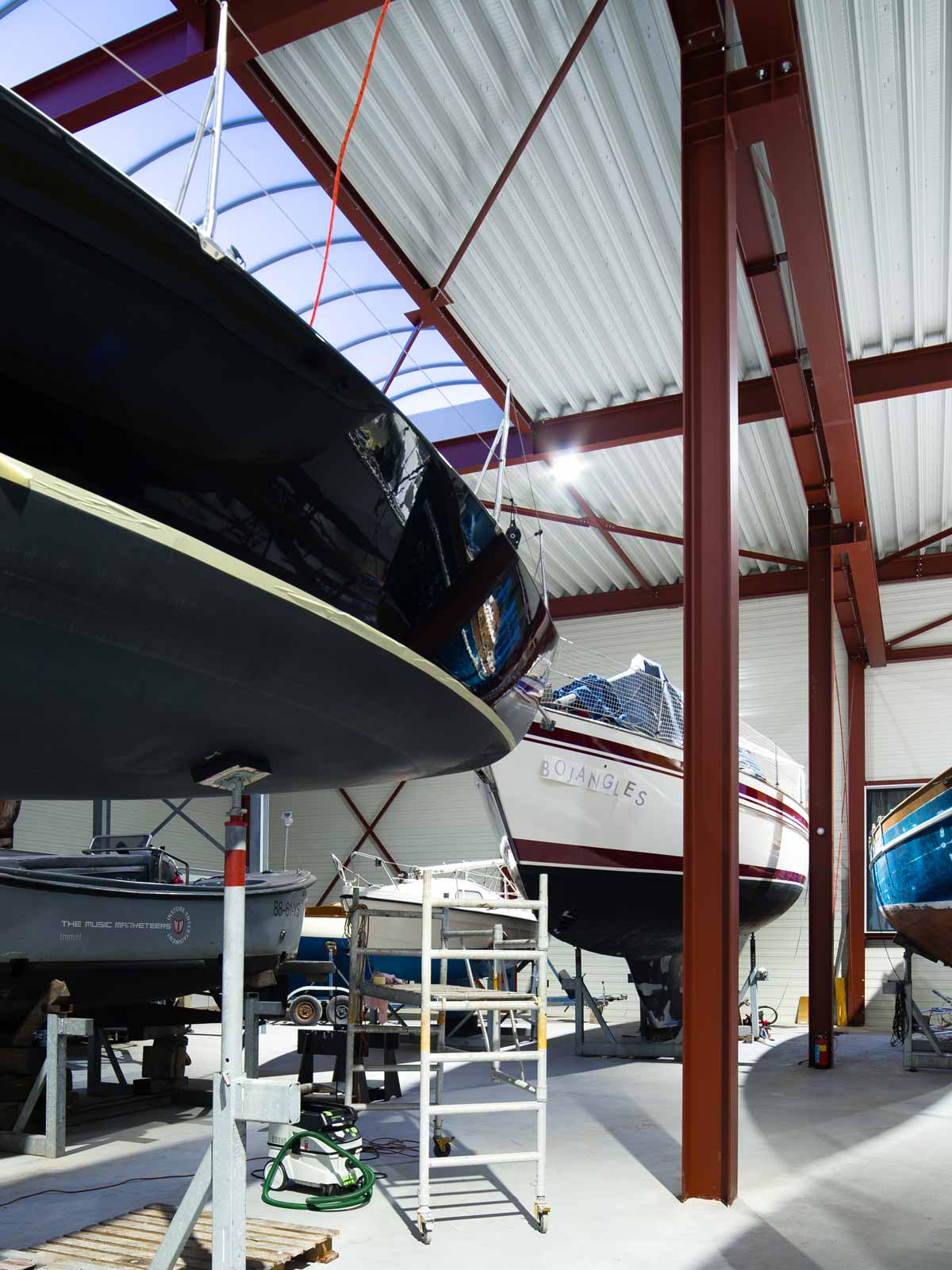 interior photo showing several yachts under repair in Boat Hangar by BETA