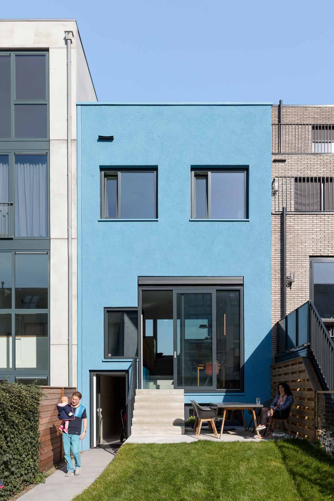 blue house by BETA exterior photo rear façade Pareidolia