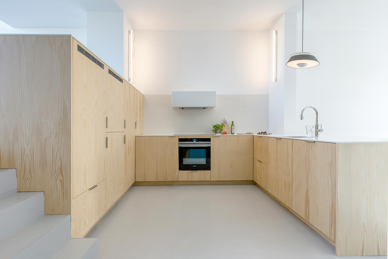 blue house by BETA intermediate level with kitchen