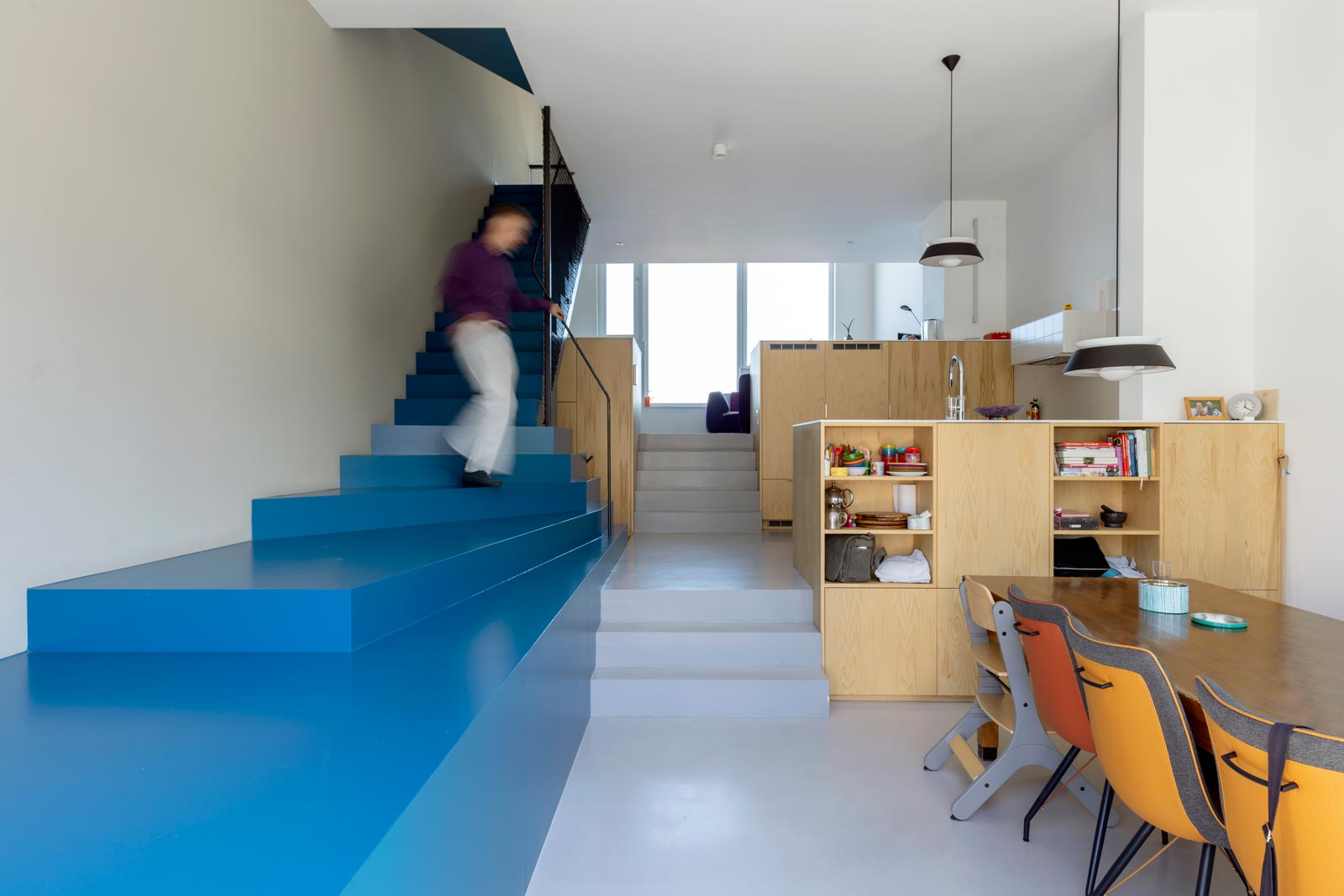 blue house by BETA sculptural staircase and kitchen