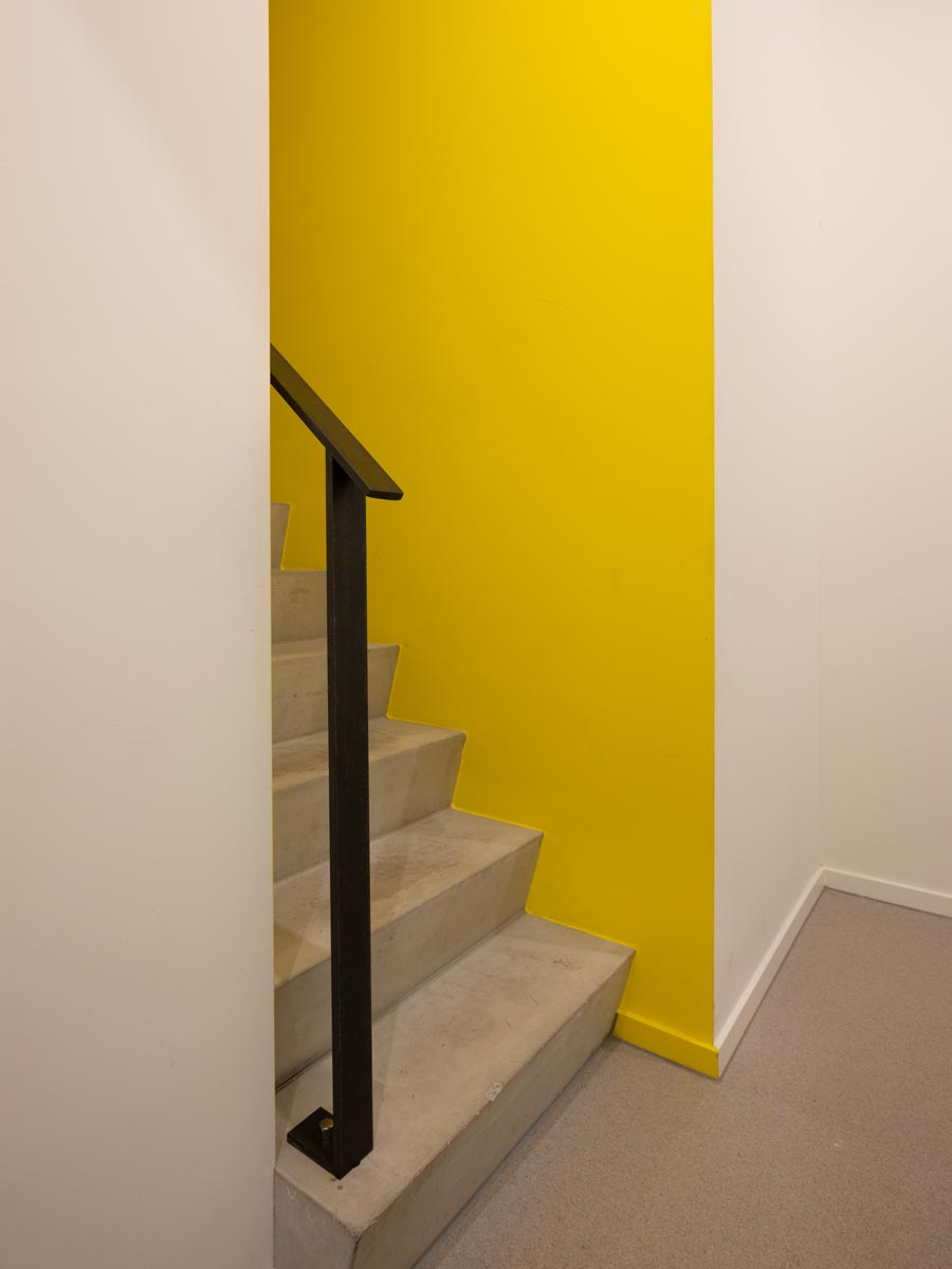 three generation house by BETA photo interior detail steel railing and yellow wall by Ossip