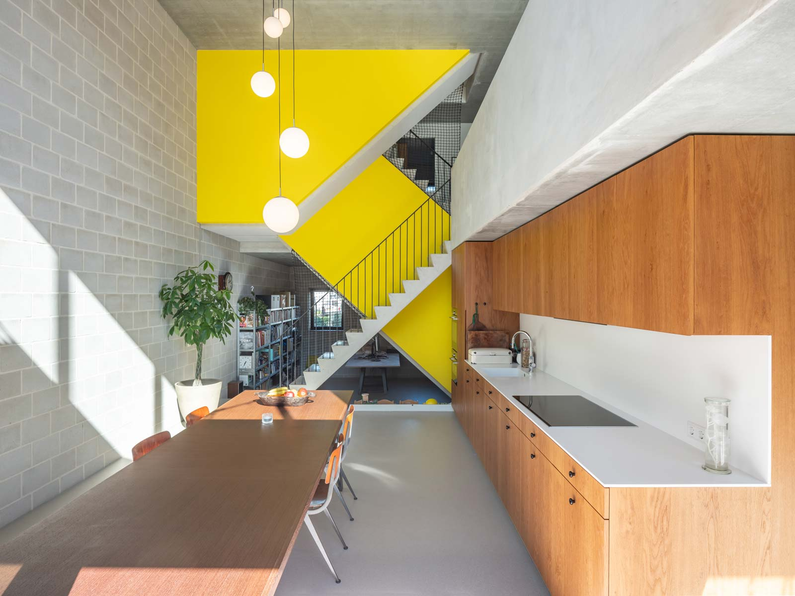 three generation house by BETA photo interior kitchen with yellow staircase by Ossip