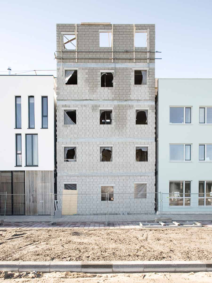 three generation house by BETA photo construction site concrete masonry grid facade