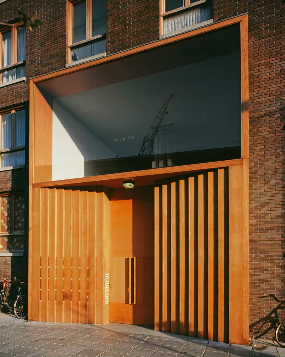 photo of a beautiful wooden apartment buidling entrance