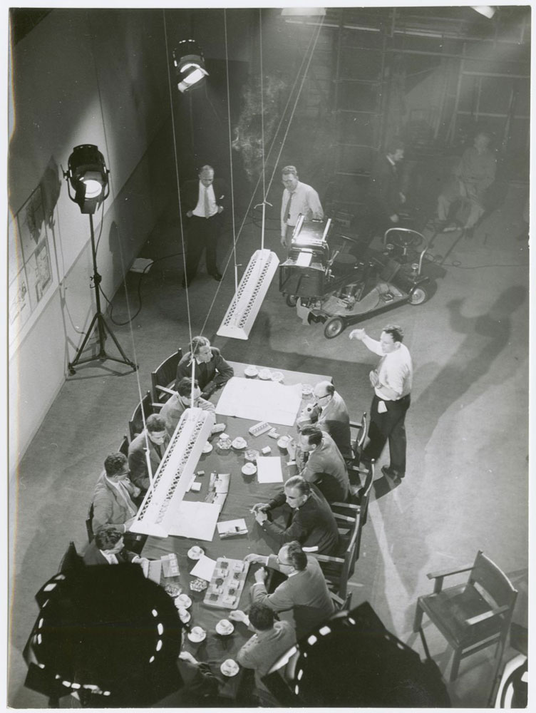 Architects discussing the design of Nagele, while acting in the film 'Een nieuw dorp op nieuw land' (A New Village on New Land) by Louis van Gasteren, 1960.